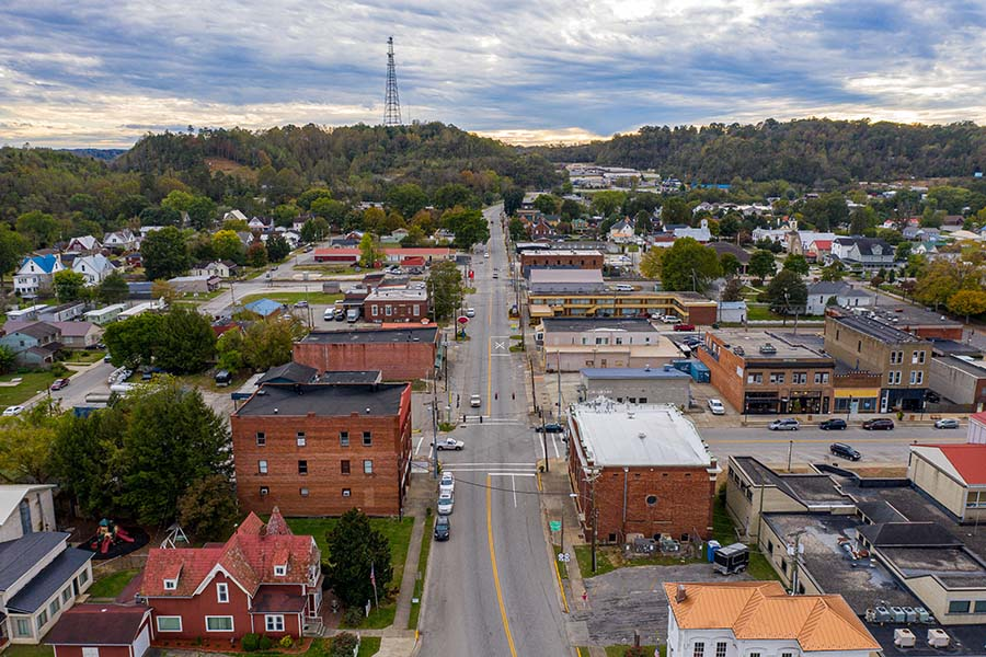 Somerset KY - Aerial View of the Small Town of Somerset Kentucky on a Cloudy Day with Views of Homes and Commercial Buildings Along Main Street