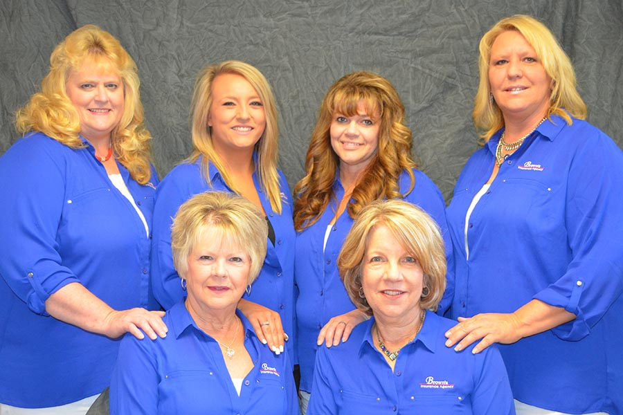 About Our Agency - Staff Photo of Brown's Insurance Agency, With Six Team Members All Wearing Blue Shirts and Standing Together