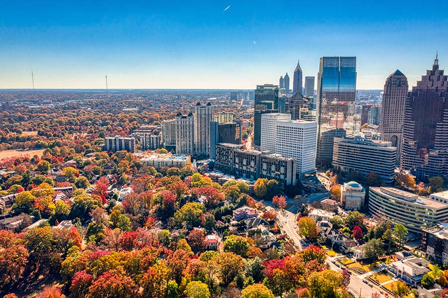 Contact - Aerial View of Downtown Atlanta Georgia Against a Bright Blue Sky During the Fall with Colorful Trees