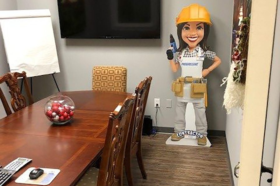Insurance Quote - Empty Conference Room Inside Lincoln Insurance Group Office with Cardboard Cutout with Flo from Progressive