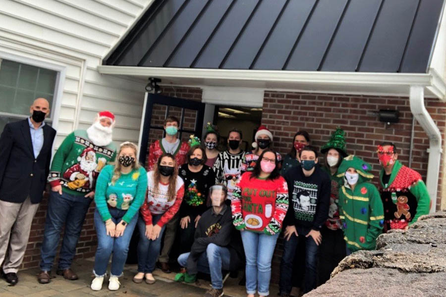About Our Agency - The Satanoff Agency Team Photo outside the Office in Christmas Attire