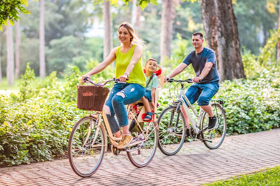 Employee Benefits - Happy Family Is Riding Bikes Outdoors