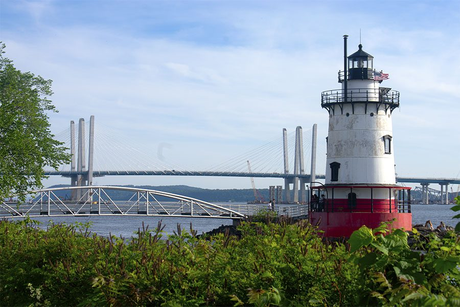 Blog - View of a Bridge and Surrounding Lighthouse By the Hudson River on a Sunny Day in Westchester New York