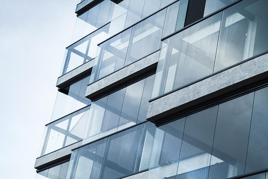 Business Insurance - Glass and Concrete Balconies on a Modern Urban Apartment Building