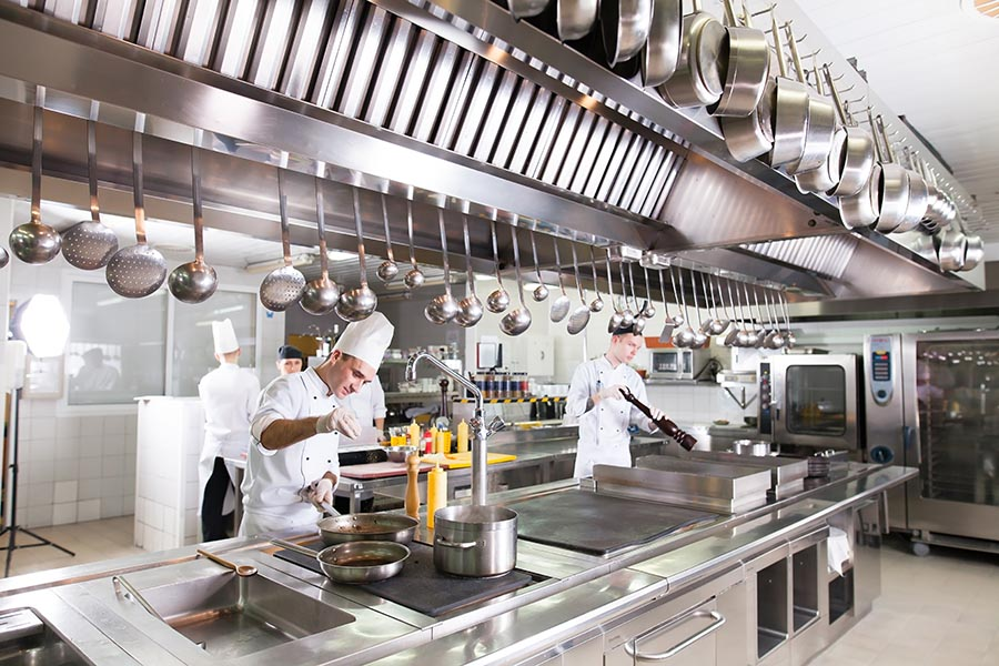 Specialized Business Insurance - Busy Professional Kitchen, With Steel Equipment, Tools and Chefs