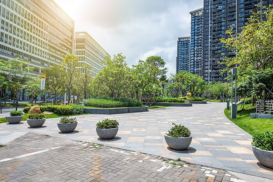 Blog - View of Office Buildings and Landscaped Setting Outside with Trees and Greenery