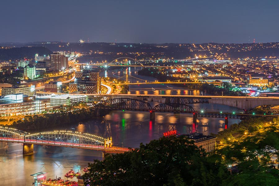 Ambridge, PA Insurance - View of Pittsburgh as Seen From a Distance, City Lit up for the Evening