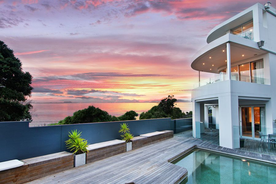 Private Client Insurance - Modern Home with Swimming Pool and Deck