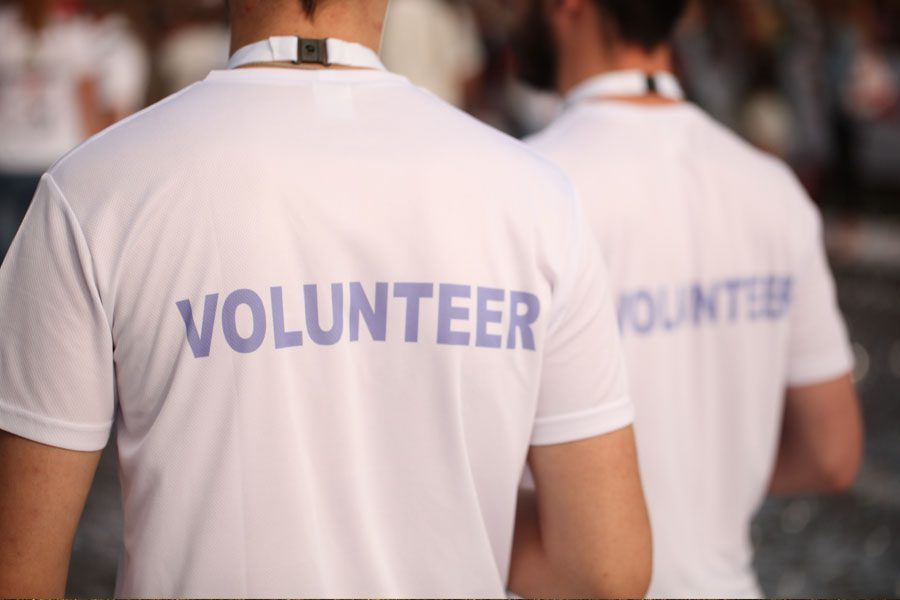 Our-Events-Group-of-Co-Workers-Standing-as-Event-Our-Events-Group-of-Co-Workers-Standing-as-Event-Volunteers
