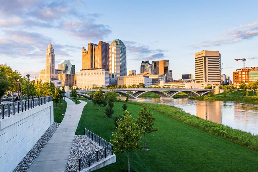 Columbus OH - View of Downtown Columbus Ohio from a Green Park in the City at Sunset