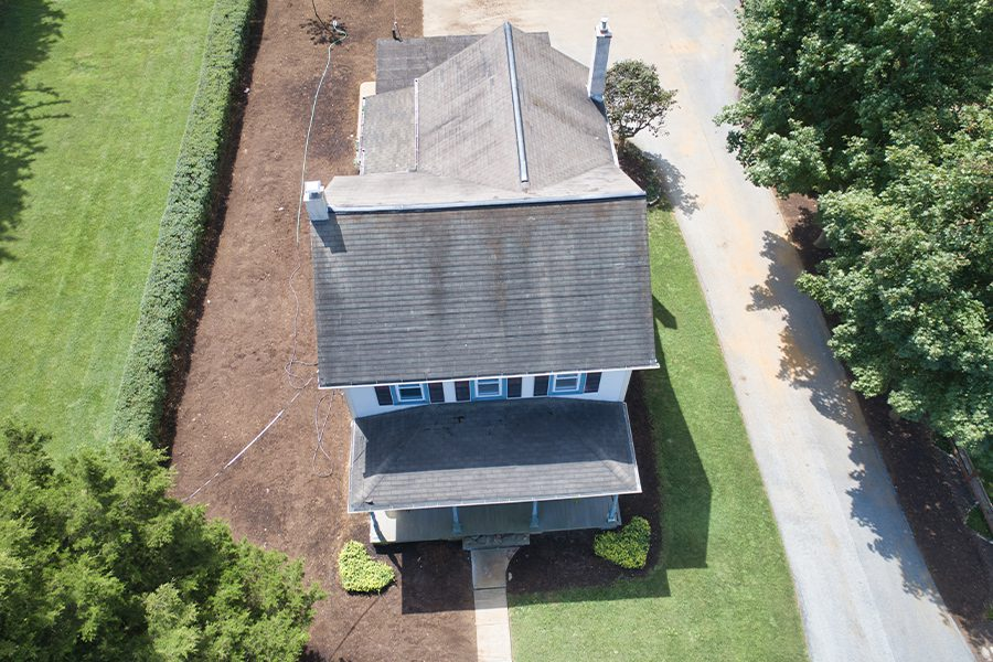 Pennsylvania - Aerial view of an Amish Farm House on a Summer Day