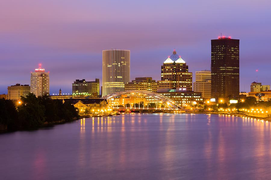 Contact - Rochester, NY Skyline at Night, Lights Reflecting off the Water, Sky Glowing Orange and Deep Purple
