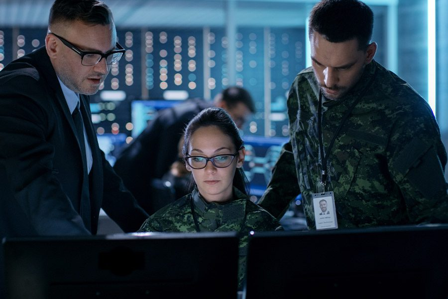 Defense Contractor Insurance - Government Surveillance Agency and Military Operation Officers Working at System Control Center