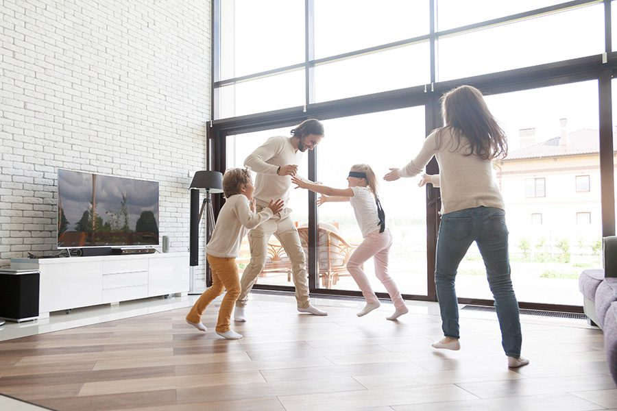 Personal Insurance - Family Having Fun in Thier Living Room