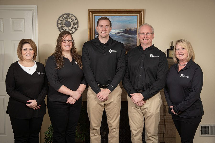 Insurance Quote - Portrait of the Tinnerman Insurance Agency Team Standing in the Office