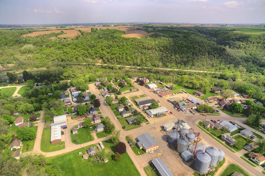 East Grand Forks MN - Aerial View of the Small Town of East Grand Forks Minnesota with Views of Commercial Buildings and Homes Surrounded by Green Foliage