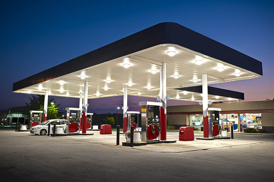 Gas Station Insurance - Night View of a Gas Station with Cars Pumping Gas