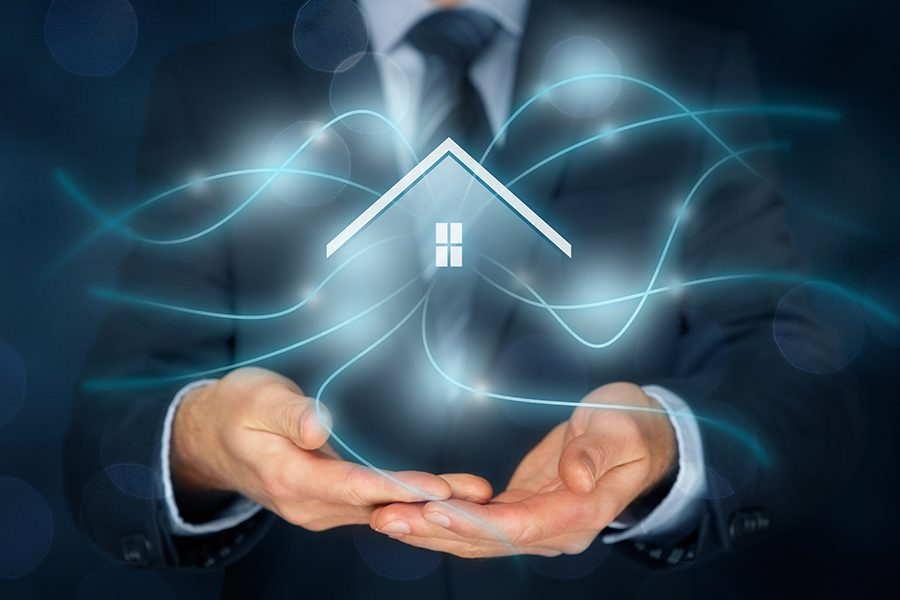 HomeSolutions Vendor Network - Businessman Holding a House in his Hands