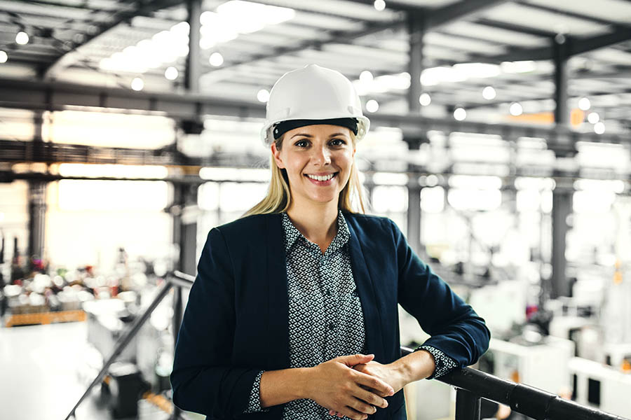 Engineer Insurance - Woman Engineer Working on Site for a New Factory