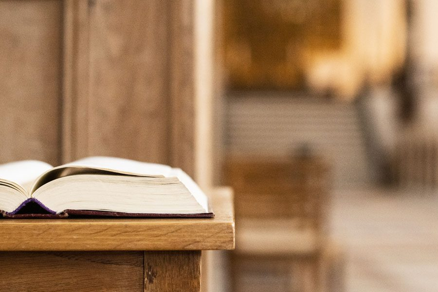Church Insurance - Holy Book Sitting on the Alter