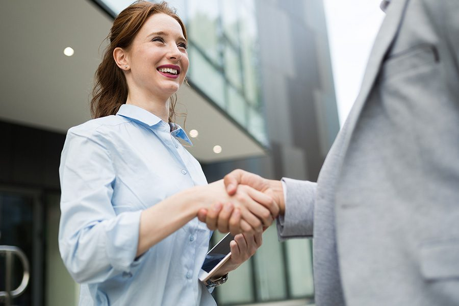 About Our Agency - Successful Business People Shaking Hands While Closing a Business Deal