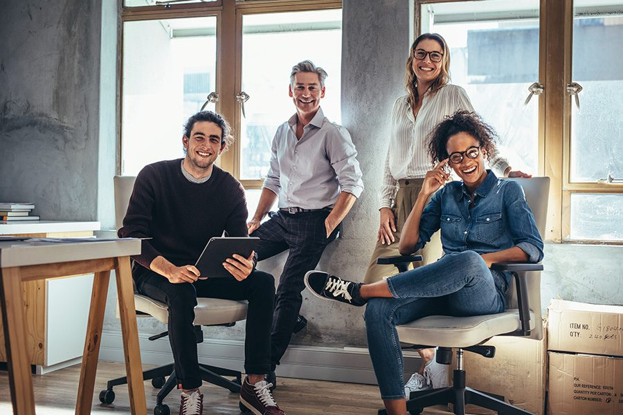 Business Insurance - Portrait of a Small Successful Business Team