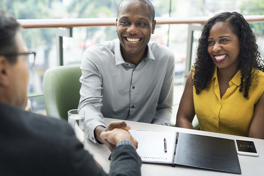 Safe Money Strategies - Couple Meeting with a Financial Planner at Their Office