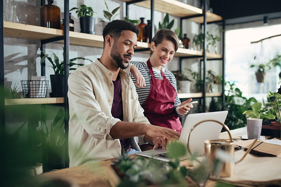 On-Demand Business Insurance - Small Business Owners Working On Their Laptop
