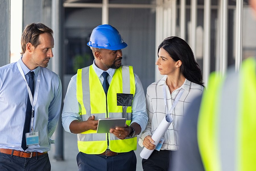 Specialized Business Insurance - Engineer and Architects at Construction Site Discussing Plans