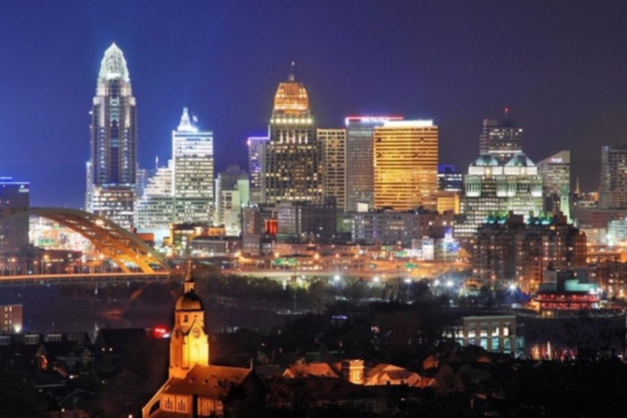 Contact - Nighttime View of Cincinnati, OH Skyline With Buildings Shining Their Lights