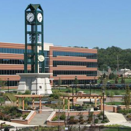 Homepage - Closeup View of Commercial Building and Clock Tower in Downtown West Chester
