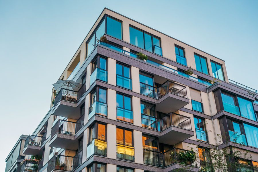 Condo Association Insurance - Condo Building with Balconies and Blue Skies