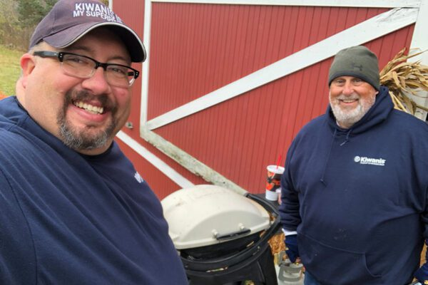 Community - Closeup Selfie of Agency Owner Ronald Hyre and Friend Smiling Outdoors