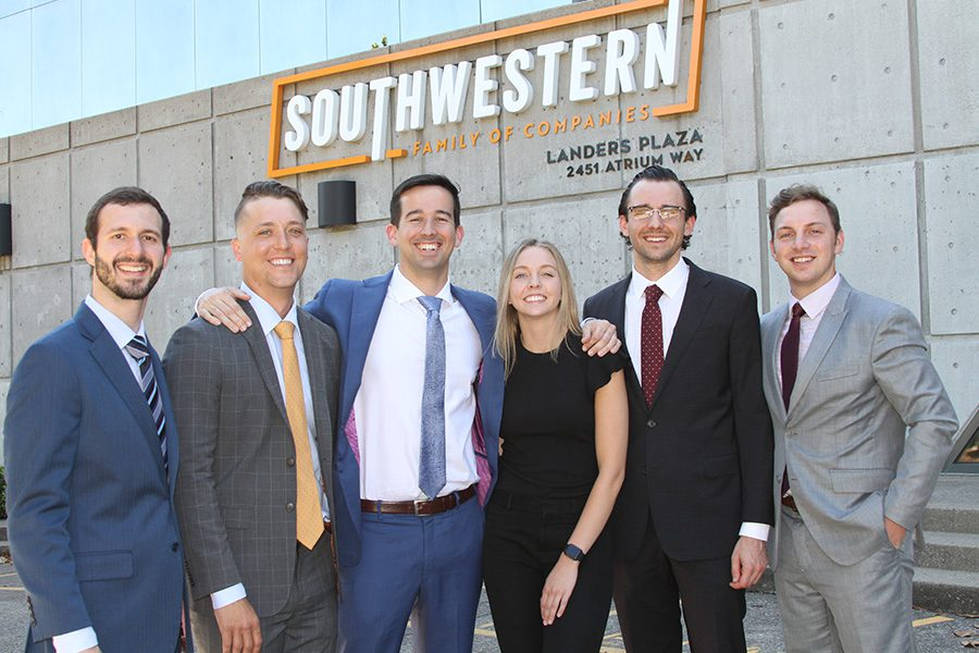 About Our Agency - Team Portrait of Southwestern Insurance Group Standing in Front of Southwest Family Companies Building on a Sunny Day