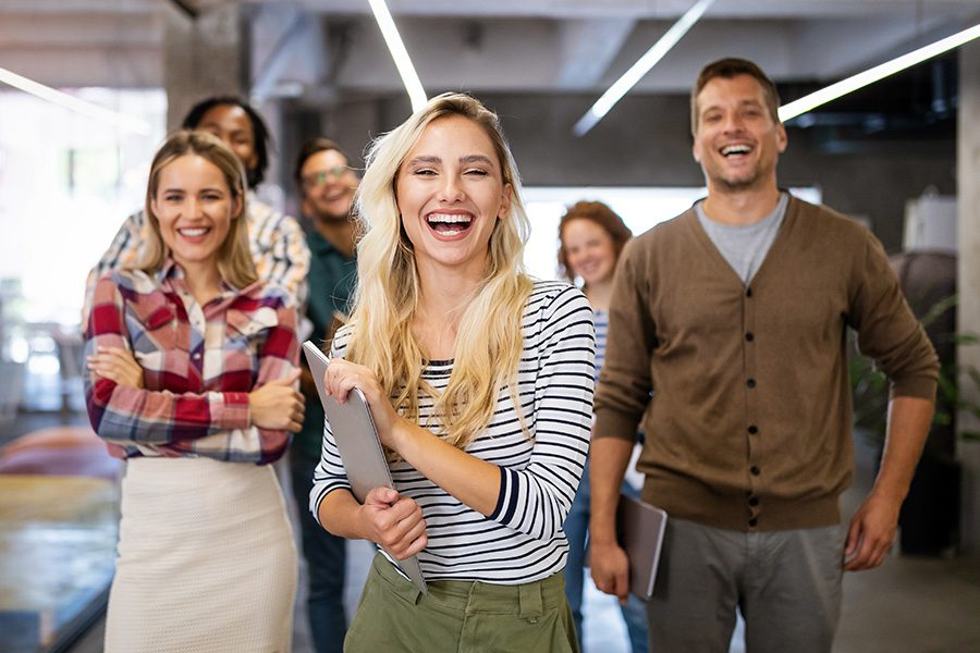 Business Insurance - Happy Portrait of a Successful Team in a Modern Office