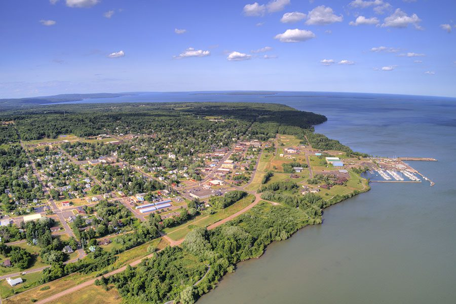 Pewaukee WI - Aerial View of the Town of Pewaukee in Wisconsin by the Lake on a Clear Sunny Day