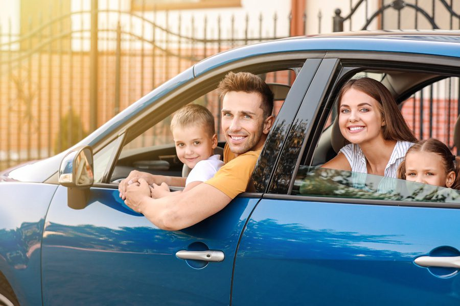 Personal Insurance - Happy Family Traveling by Car