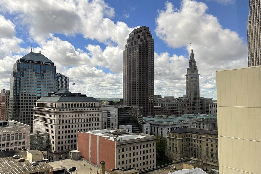 Blog - View of Surrounding Commercial Buildings Against a Cloudy Blue Sky from the Armada Risk Partners Office Building