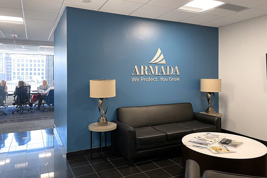 Contact Us - View of the Armada Risk Partners Lobby Room in the Office with Views of a Business Meeting in the Background