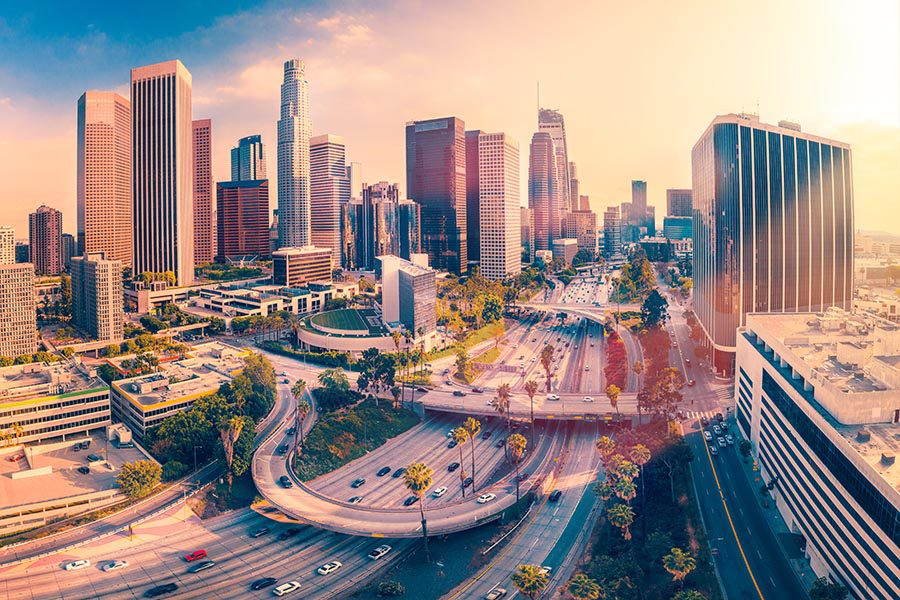 Contact - Los Angeles Scenic View, High Rises and Busy Highways Glowing in the Sun, Palm Trees Along the Roads