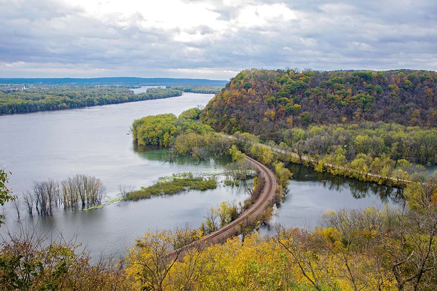 Contact - Aerial View of a River Surrounded by Mountains with Colorful Fall Foliage in Iowa