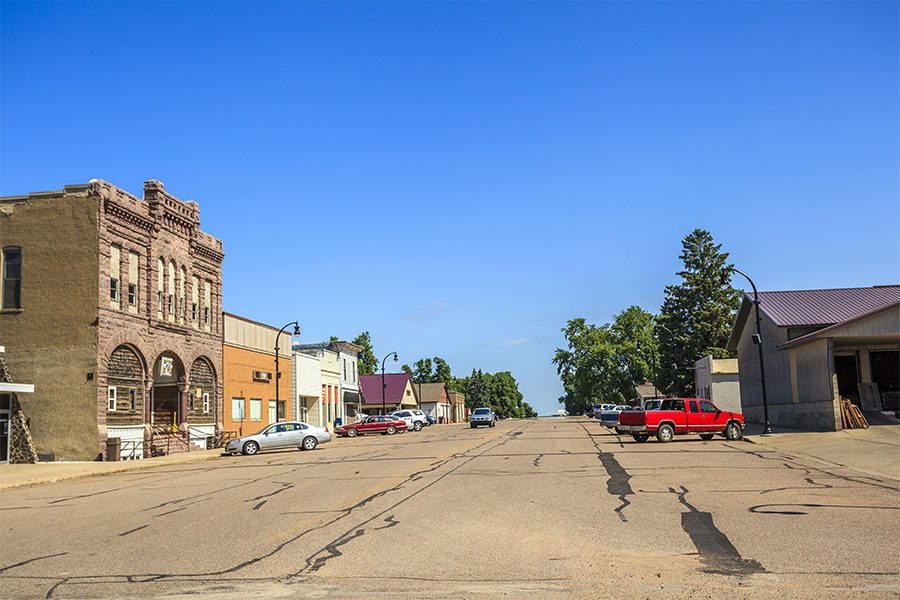 Victor IA - View of Commercial Buildings and Parked Cars Along the Main Street in Downtown Victor Iowa