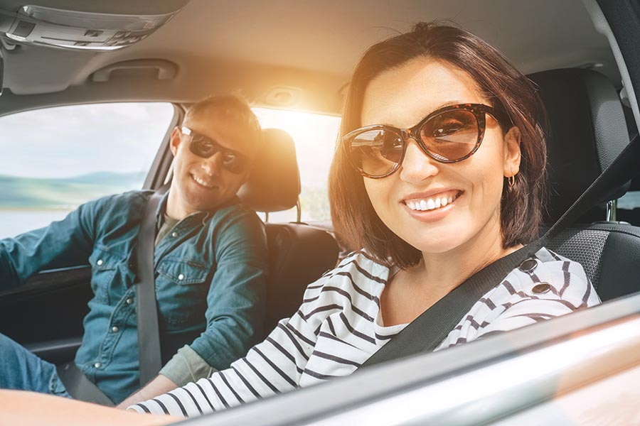Contact - Young Couple Wearing Sunglasses Smile and Set Off on a Road Trip, Seatbelts Buckled