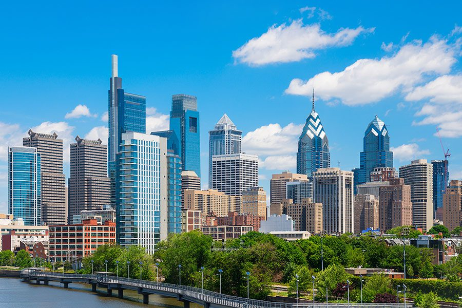 Contact - View of Philadelphia City Scape During the Daytime with a Few Clouds