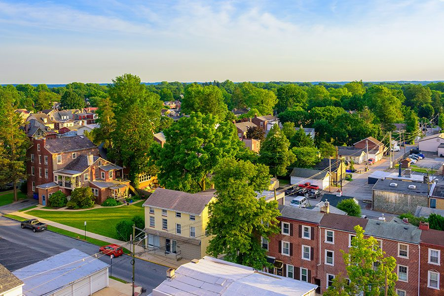 Levittown, PA - Aerial View of Suburban Houses and Sunset Sky