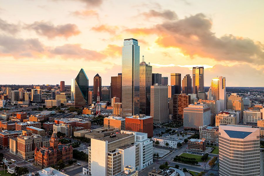 Contact - Aerial View of Dallas, Texas Cityscape at Dusk