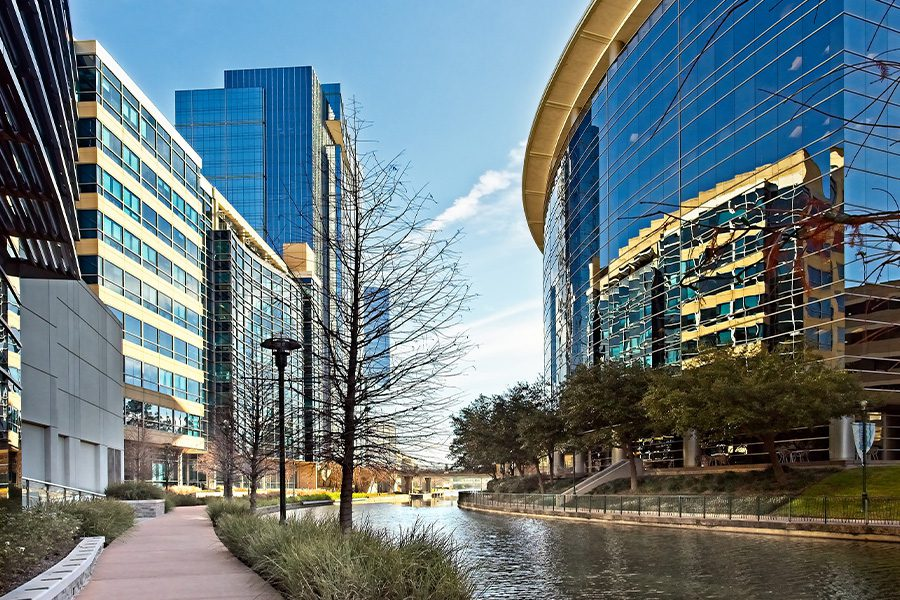 The Woodlands, TX - Waterway with Glass Buildings in The Woodlands, Texas