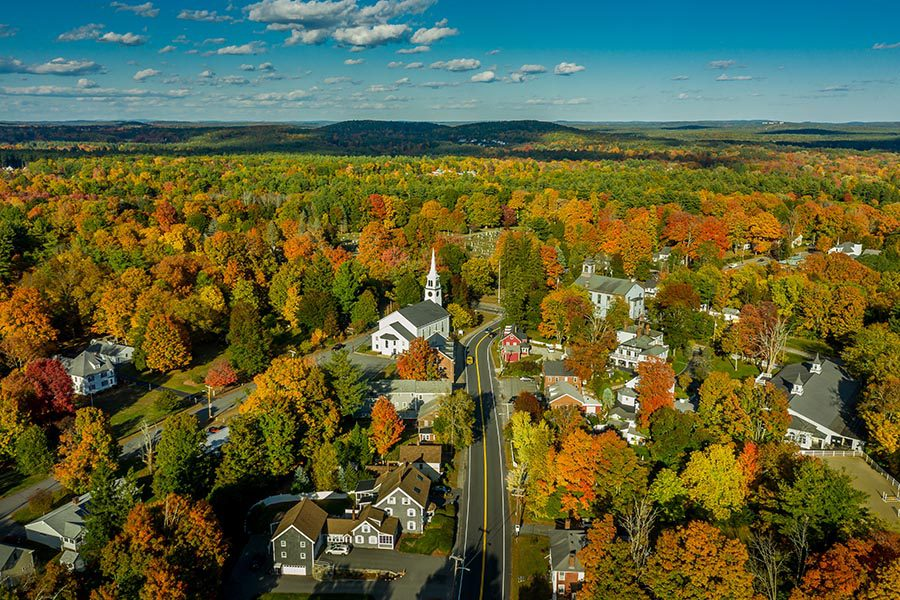 Whitman, MA Insurance - Birds Eye View of a New England Town in Autumn