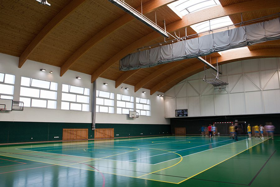 Sports Facility Insurance - Interior of a Modern Multifunctional Gymnasium with Young Athletes