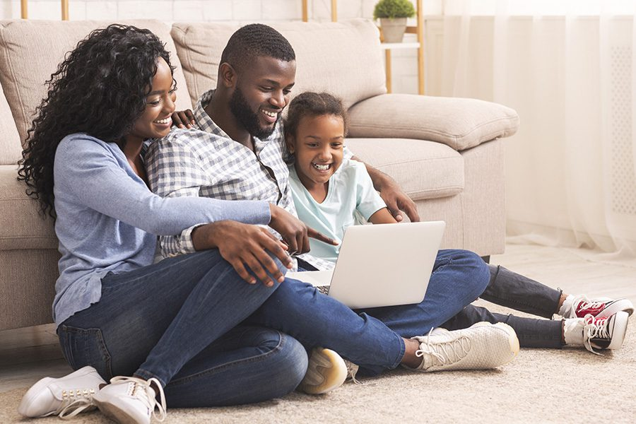 Personal Insurance - Family of Three Using Laptop Together at Home